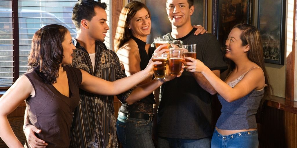 sharing a beer with friends