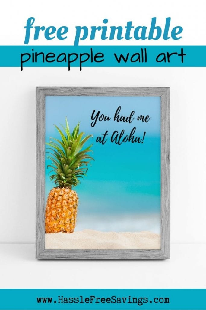 "Free Printable ""You Had me at Aloha"" Pineapple Quote Fresh Looking Pineapple sitting on the beach sand with a beautiful ocean in the back."